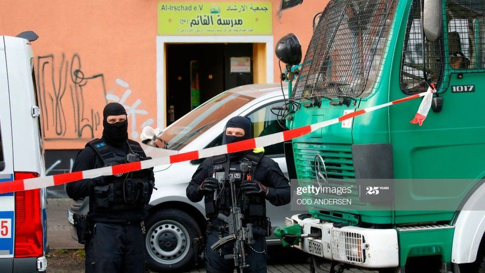 Police stand in front of Al-Irschad Mosque during a raid on April 30, 2020 in Berlin
