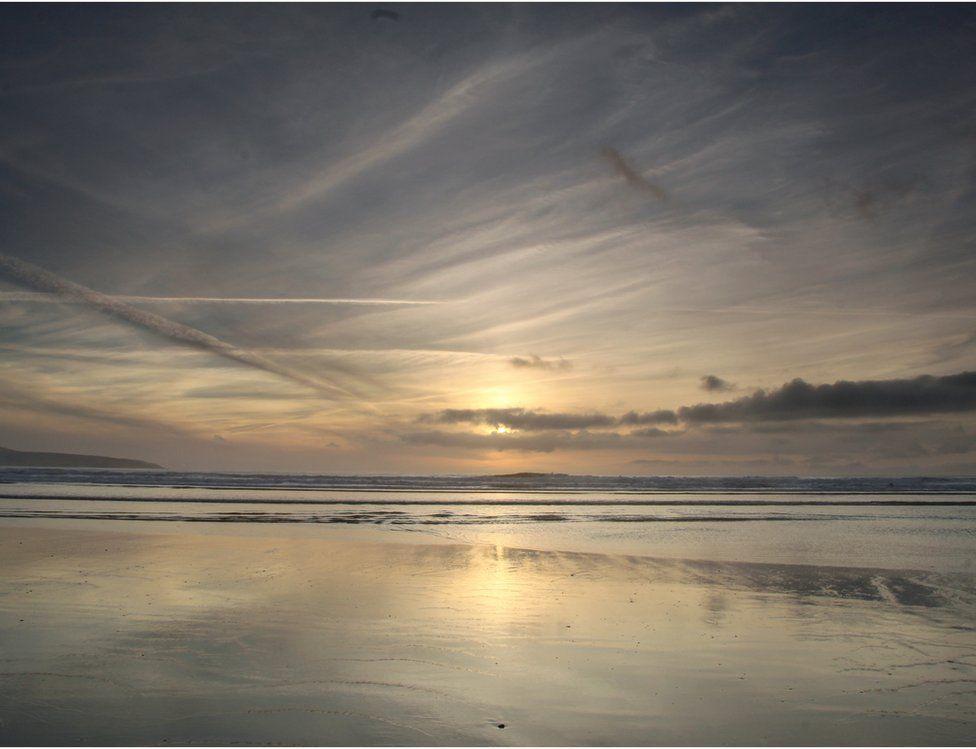 Sunset mirrored on a beach
