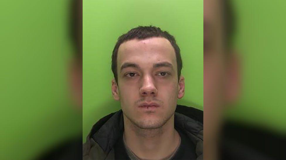 Inmate who slashed Nottingham prison officer's throat sentenced