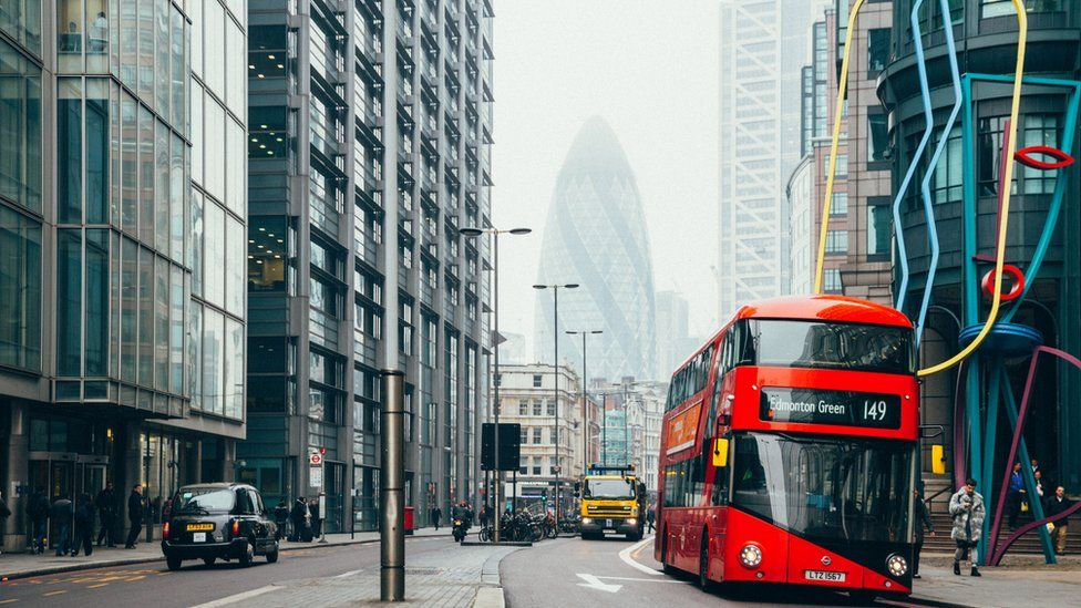 Photo of a bus driving through London