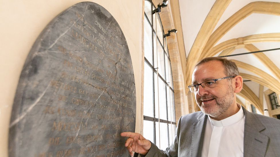Bamberg Archdiocese official Norbert Jung with the marble gravestone