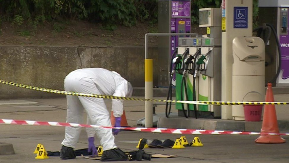Forensic officer investigates crime scene