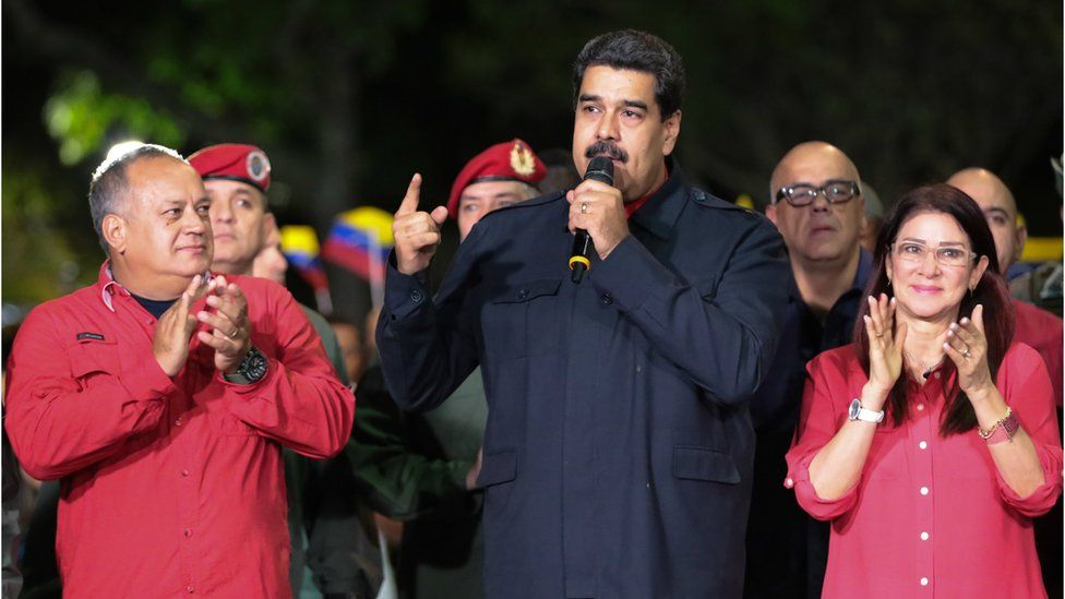 President Nicolas Maduro flanked by supporters