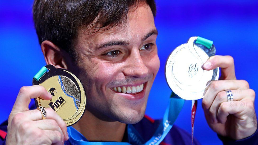 Tom Daley poses with two medal he won at the the Budapest 2017 FINA World Championships on July 22, 2017 in Budapest, Hungary.