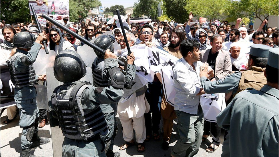 Afghan policemen clash with demonstrators during a protest in Kabul, Afghanistan 2 June 2017