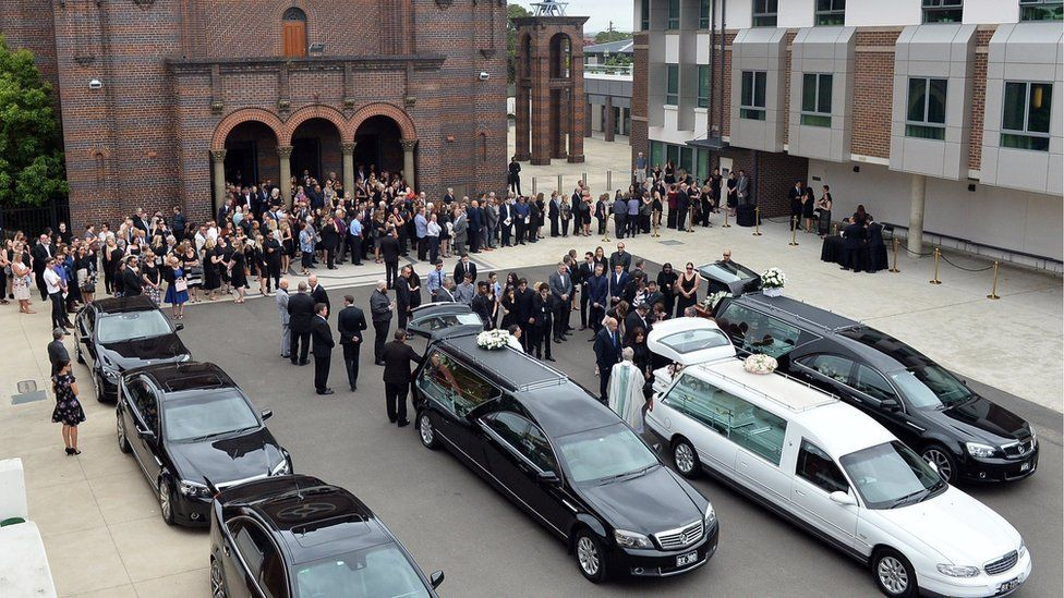 Family and friends at the funeral of Lars, Vivian and Annabelle Falkholt