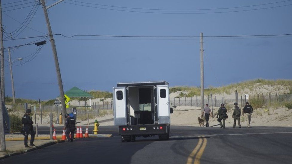 """Police officers patrol near the scene of a """"pipe bomb-style device"""" explosion on 17 September, 2016 in Seaside Park, New Jersey"""