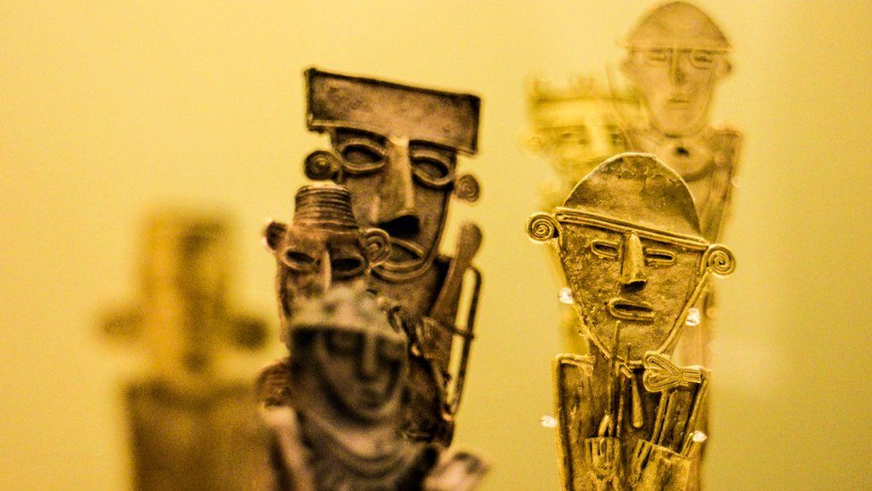 A collection of gold figurines
