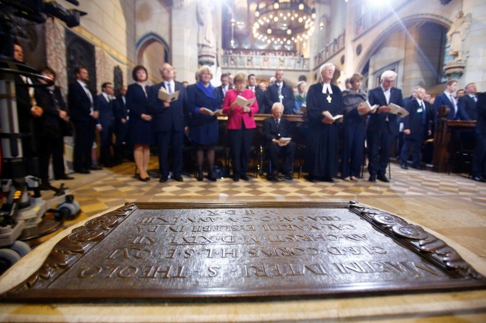 German Chancellor Angela Merkel, German President Steinmeier and President of Germany's lower house of parliament Bundestag Schaeuble attend the 500th anniversary of the Reformation in front of the grave of Martin Luther at the Castle Church in Wittenberg, Germany, 31 October 2017