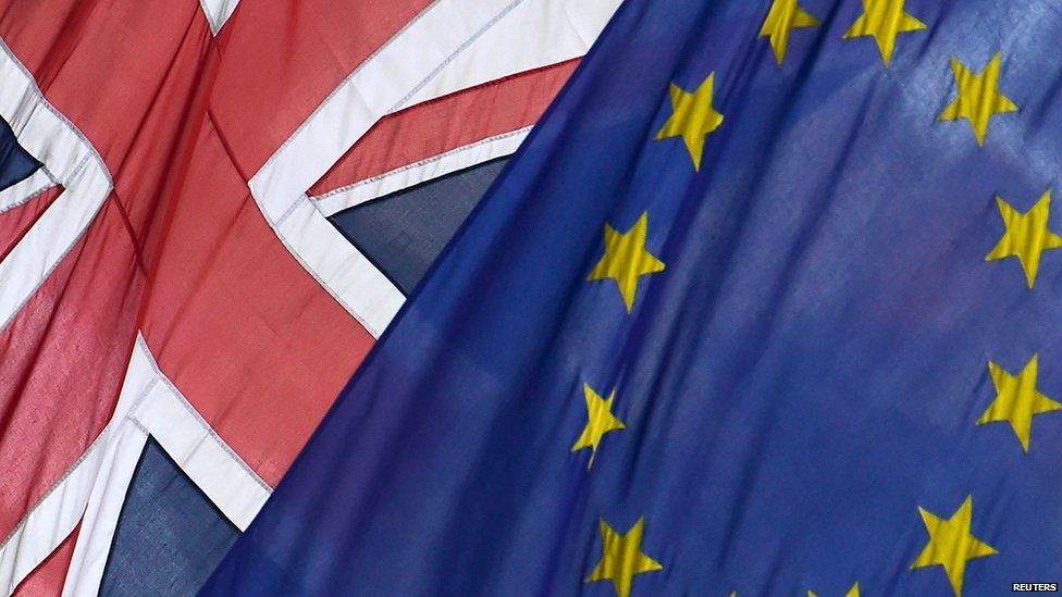 British Union flag and European Union flag are seen hanging outside Europe House in central London June 9, 2015.