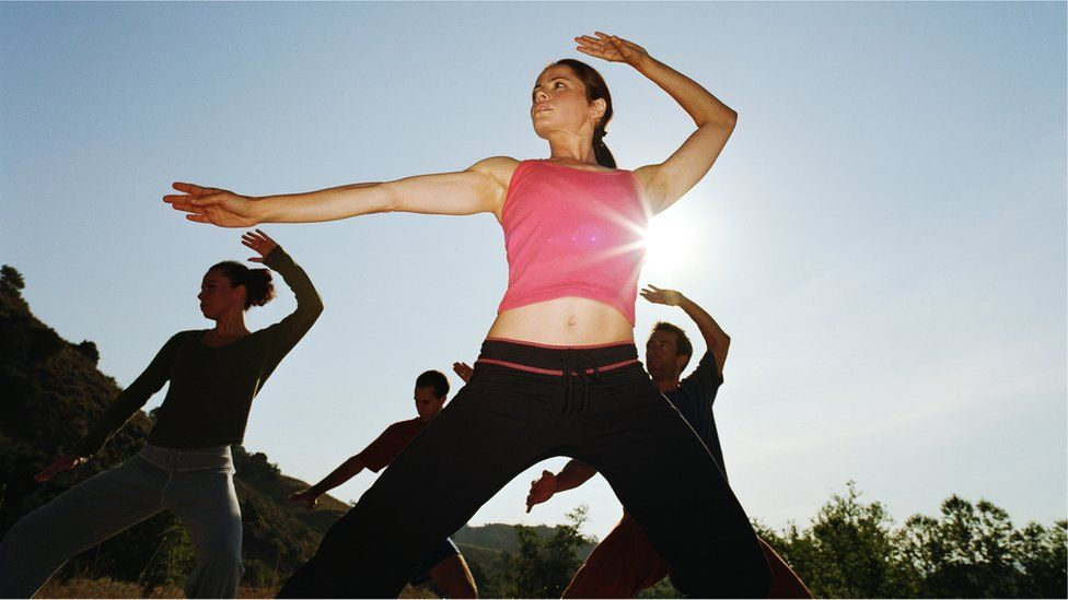 An outdoors tai chi group