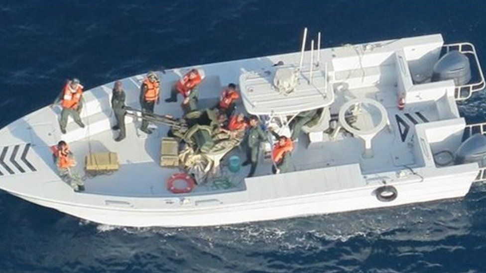 US Department of Defense: Imagery taken from a U.S. Navy MH-60R helicopter of the Islamic Revolutionary Guard Corps Navy after removing an unexploded limpet mine from the M/T Kokuka Courageous.