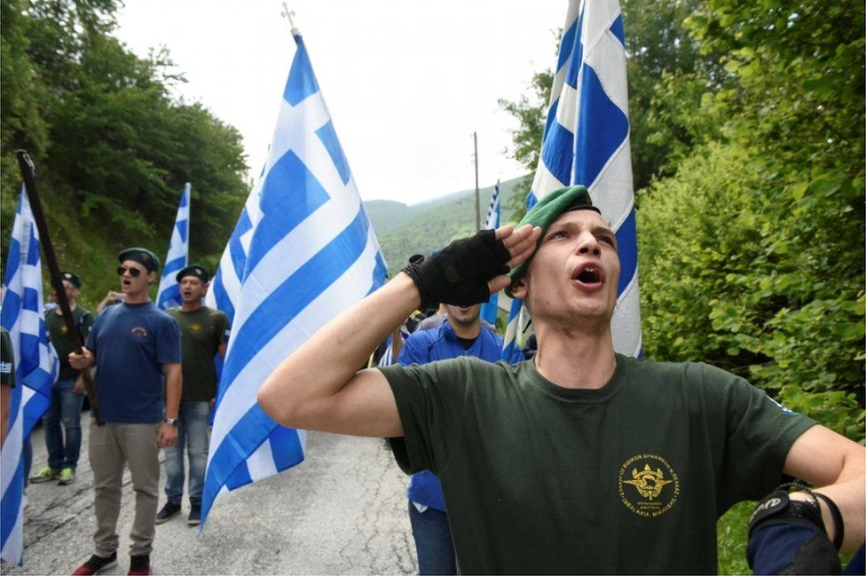 Protesters chant the Greek national anthem during a demonstration against the agreement reached by Greece and Macedonia to resolve a dispute over the former Yugoslav republic's name, in Pisoderi village, northern Greece, 17 June 2018