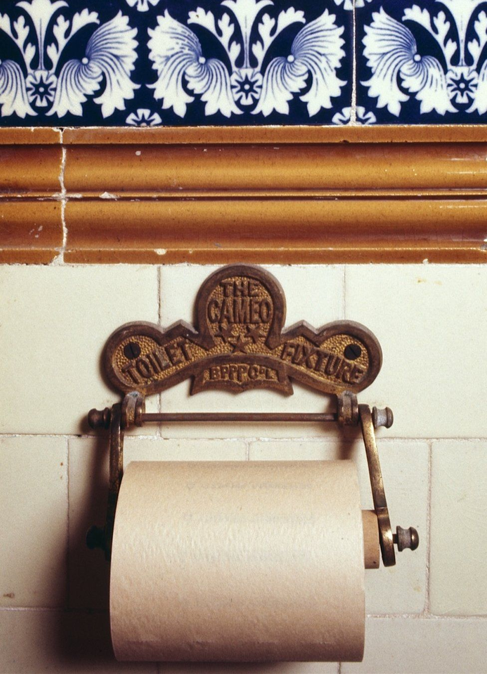 An early toilet roll holder designed by the British Perforated Paper Company