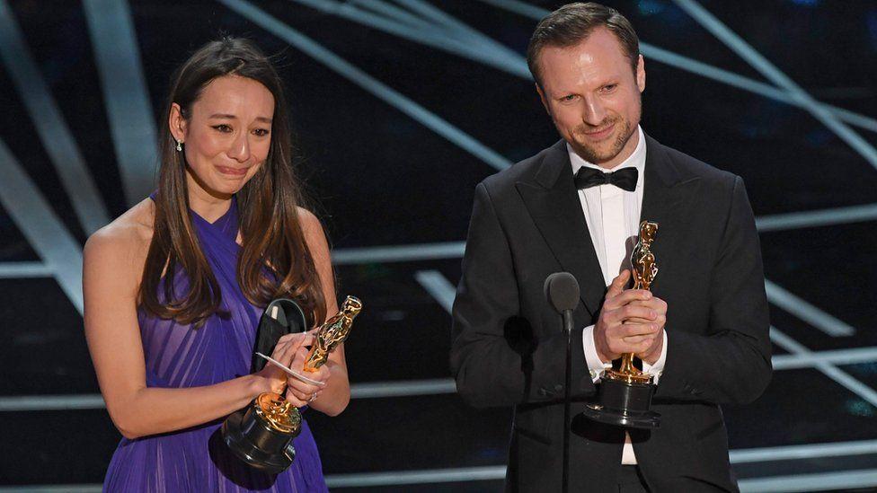 Producer Joanna Natasegara and director Orlando von Einsiedel accept their Oscar award