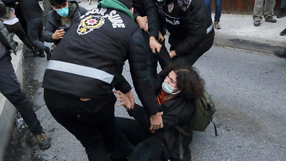 A woman scuffles with officers at Bogazici University, 1 February