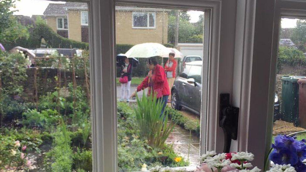 Sightseers in people's front gardens