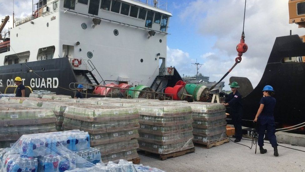 Handout photograph shows supplies being loaded on US coast guard vessel