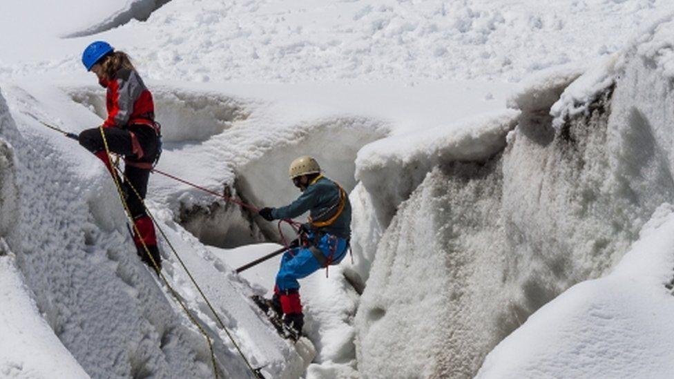 Mountaineers climbing the Alps