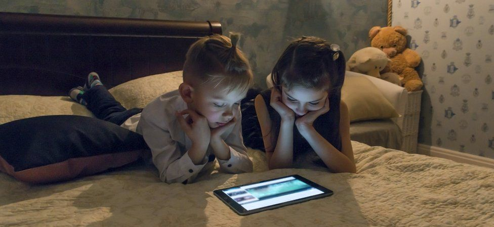 Children watching iPad