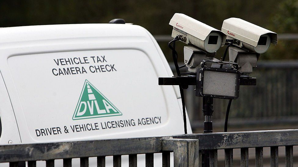 A number plate recognition camera, operated by the UK's Driver and Vehicle Licensing Agency, scans the M77 motorway for vehicles