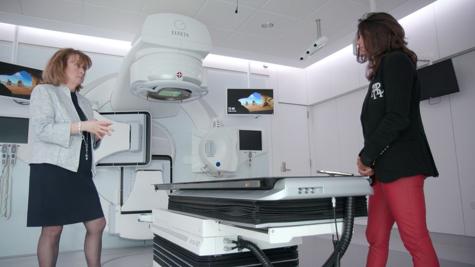 female consultant explaining machine to woman