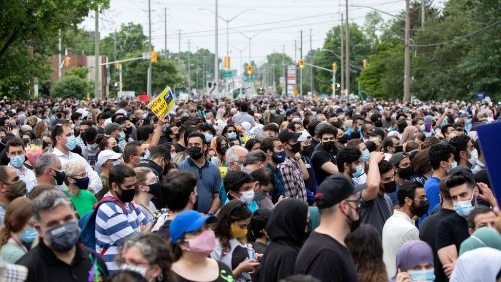 A crowd gathers at a London, Ontario vigil for the Afzaal-Salman family