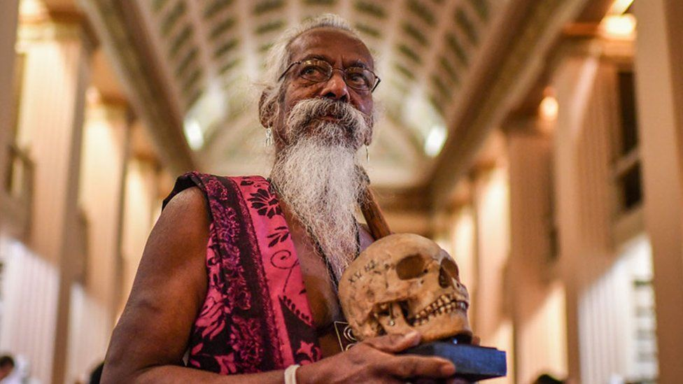 Vedda chief Wanniya Uruwarige with skull