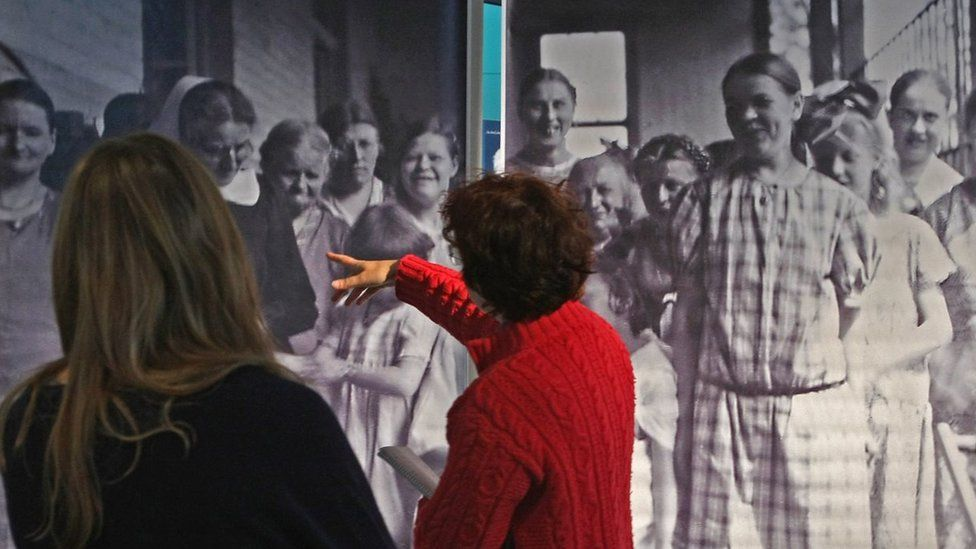 Visitors look at a photo of victims of the 'Aktion T4' Project, the policy leading to extermination of the disabled during the Holocaust,