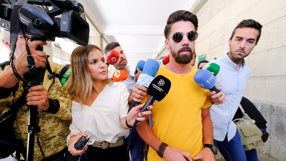 Jesus Escudero (C), one of the five men accused of gang raping a woman back in 2016 during the San Fermines Fiesta, leaves a court in Seville, 21 June