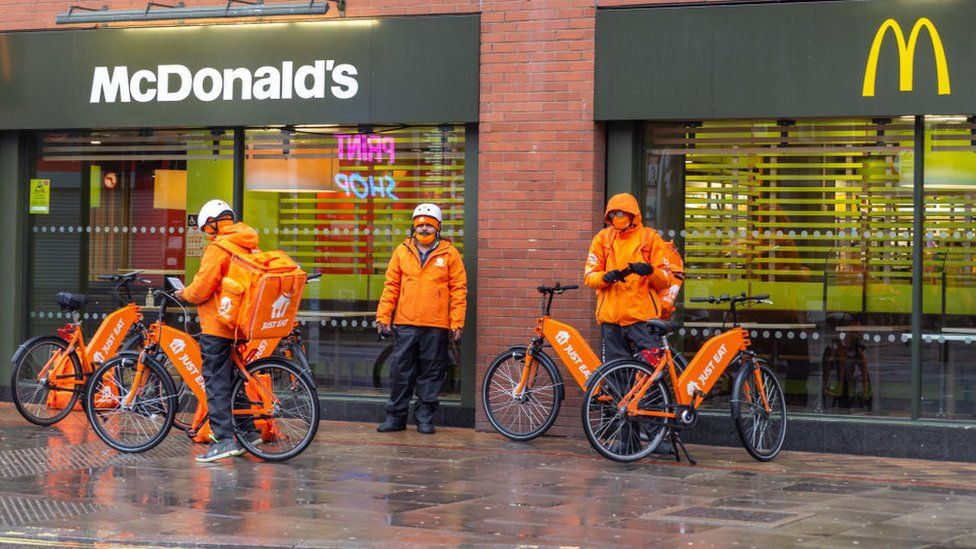 Just Eat Takeaway riders outside of a McDonald's outlet.