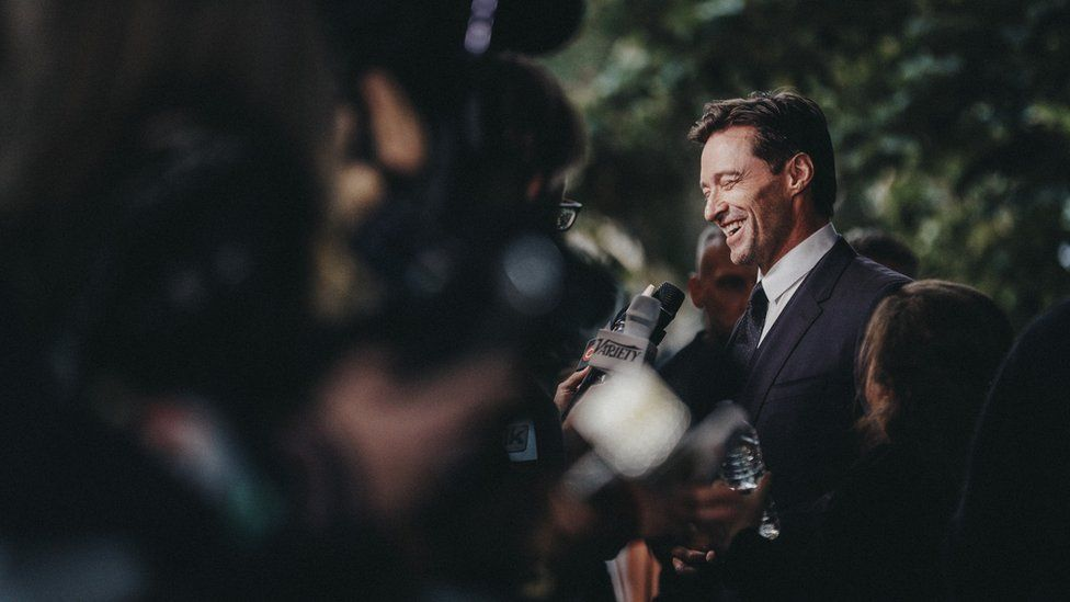 Hugh Jackman talks to the press outside the premiere of The Front Runner