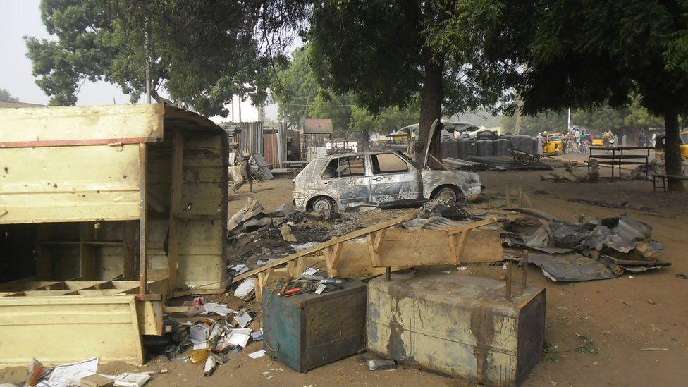 Scene of an explosion in a mobile phone market in Potiskum, Nigeria, Monday Jan. 12, 2015. Two female suicide bombers targeted the busy marketplace on Sunday.