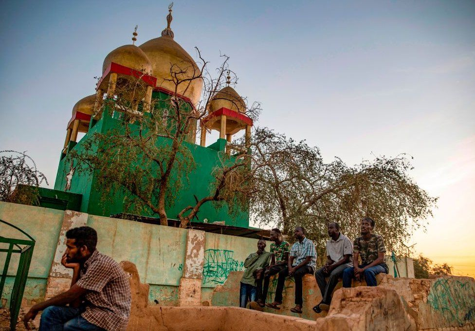 Sudanese Sufi Muslims gather outside the Hamad al-Nile shrine in Omdurman, the capital Khartoum's twin city, on January 15, 2021, for their weekly meeting after the Friday prayer, highlighted with poetry, mystical chants and dance.