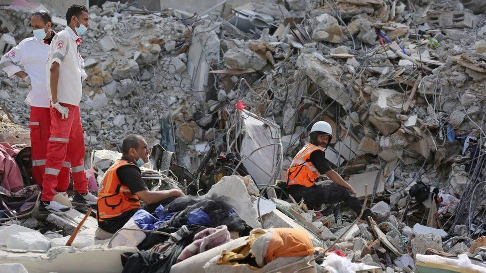 Search and rescue work continues at debris of a building after air strikes by Israel in al-Rimal, Gaza