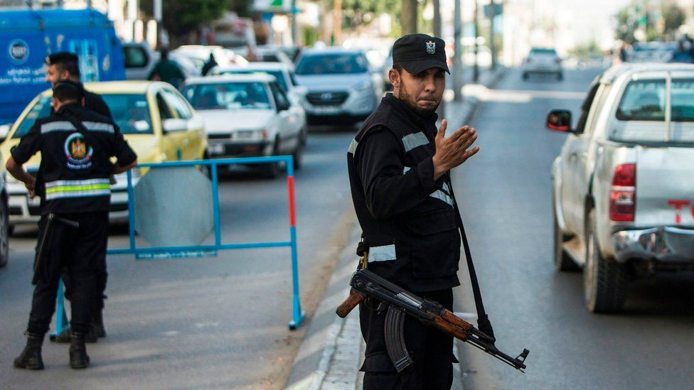 Hamas security forces personnel stand at a security checkpoint in Gaza City on 5 April 2017