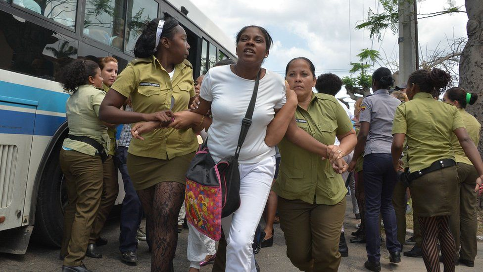 Members of dissident group Ladies in White are detained during their protest on 20 March in Havana