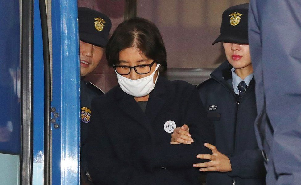 Choi Soon-Sil being escorted after questioning at the Seoul Central District Prosecutors Office