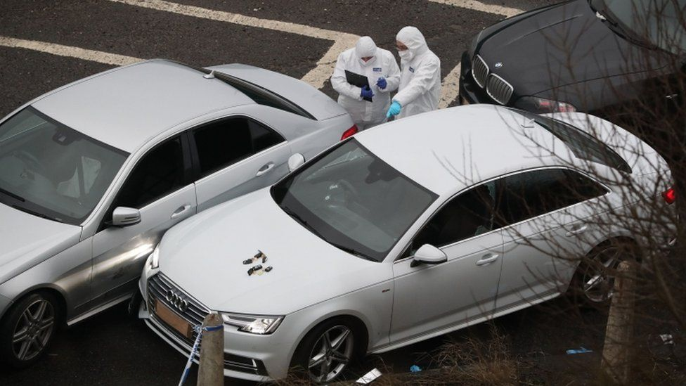 Police forensics officers at the scene near junction 24 of the M62