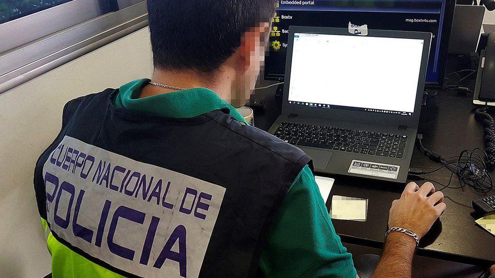 Police officer on laptop