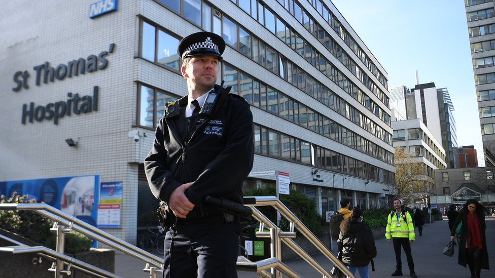 """A policeman outside St.Thomas"""" Hospital in London, Britain, 07 April, 2020. British Prime Minister Boris Johnson is being treated for Coronavirus at St. Thomas"""" Hospital, and was moved to the Intensive Care Unit after his condition worsened"""