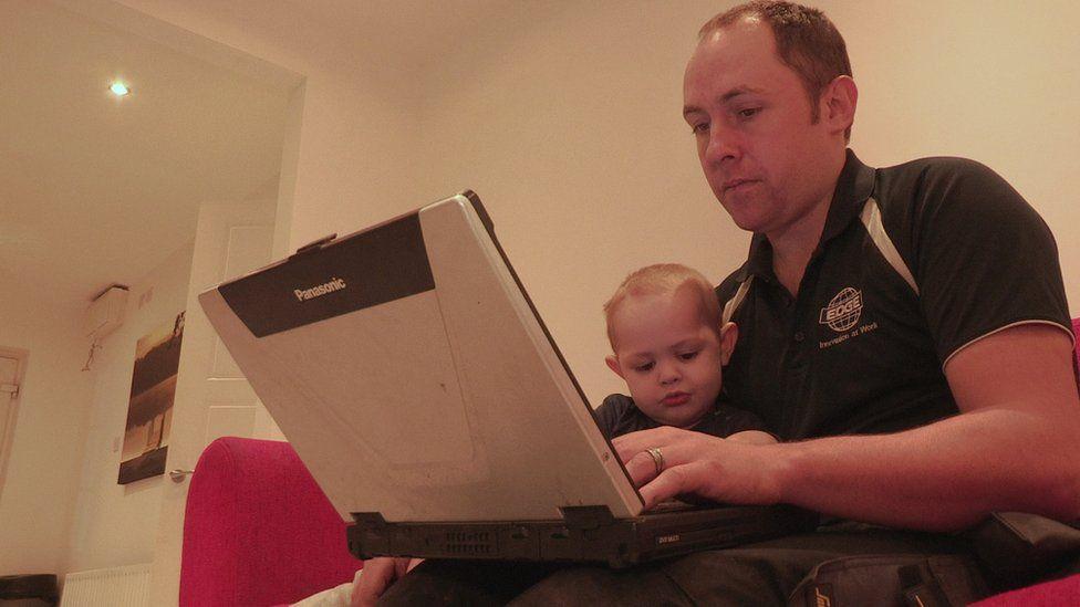 Matthew McAfee checking computer