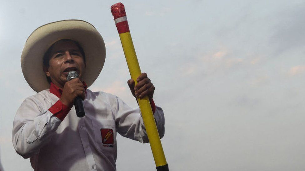Peruvian left-wing presidential candidate for Peru Libre party, Pedro Castillo, delivers a speech as he holds a big pencil, symbol of the party during a rally on 25 May