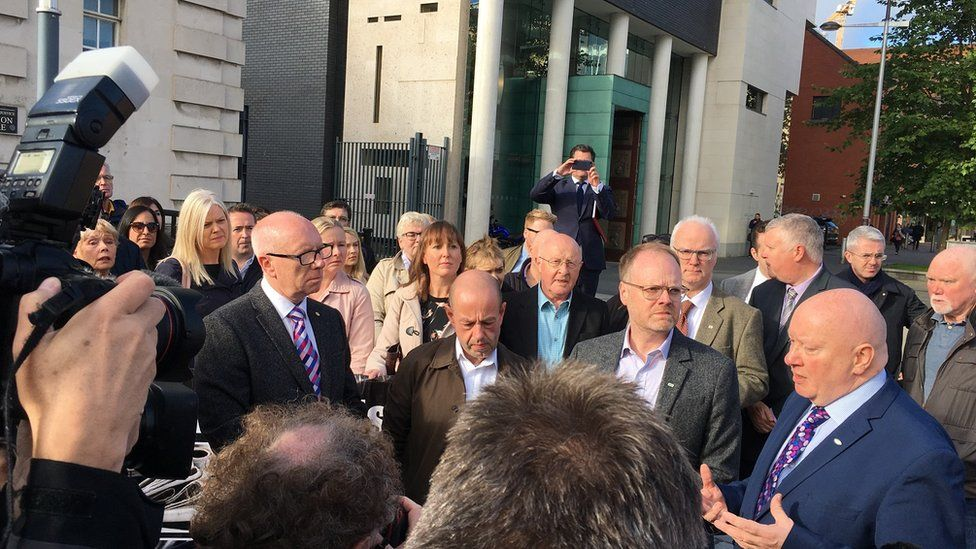 Barry McCaffrey and Trevor Birney outside the High Court in Belfast