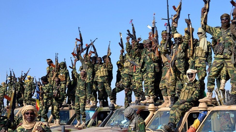 Chadian soldiers gather on February 1, 2015 near the Nigerian town of Gamboru, just accros the border from Cameroon