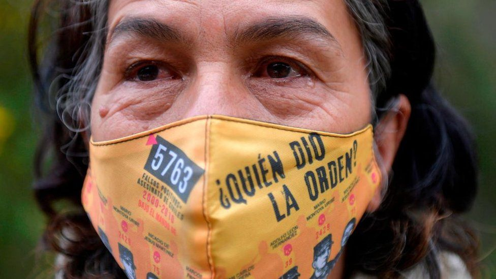Colombian Doris Tejada, whose son disappeared 12 years ago, and member of the Mothers of False Positives (Mafapo) civil organization, wears a face mask reading Who gave the order? against the spread of the novel coronavirus as she cries during an interview with AFP in Soacha, Colombia, on May 6, 2020.