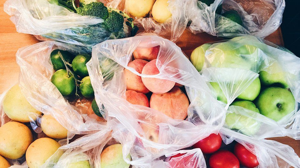 Fruit and vegetables in plastic carrier bags