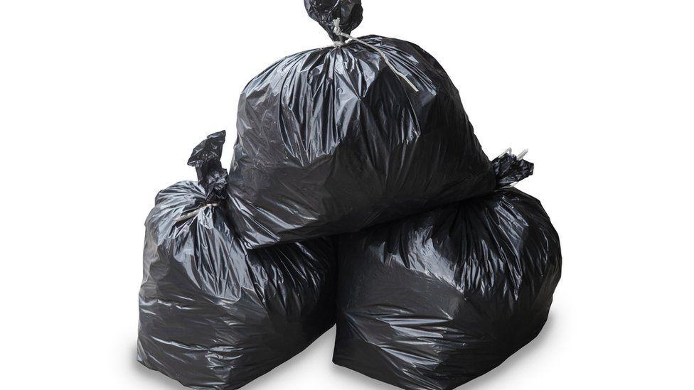 Three black bags