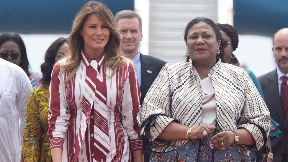 US First Lady Melania Trump walks alongside Rebecca Akufo-Addo, the First Lady of Ghana,