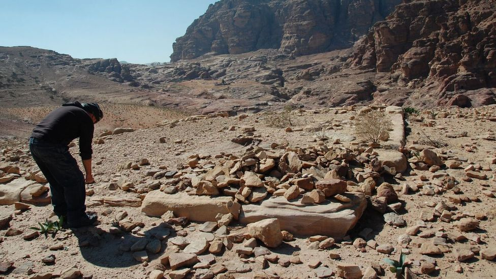 An archaeologist inspects ruins in Petra